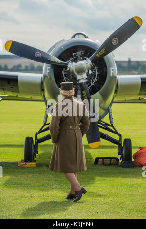 Duxford, UK. 23rd Sep, 2017. Re-enactors in perod costume pose with planes - Duxford Battle of Britain Air Show - Stock Photo