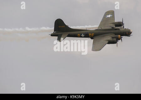 Duxford, UK. 23rd Sep, 2017. A flying fortress prepares to land after simulating an engine fire - Duxford Battle - Stock Photo