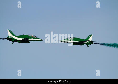 Two aircraft of the Saudi Hawks aerobatic team of the Royal Saudi Air Force appear on a collision course, but they - Stock Photo