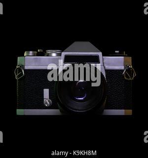 A vintage film camera on black background. - Stock Photo
