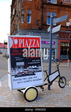 Restaurant advert on a bicycles in Oban - Scotland UK - Stock Photo