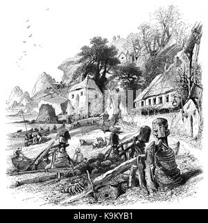 1870: In front of traditional thatched cottages, boatmen prepare their fishing boats beached on Babbicombe Bay, - Stock Photo