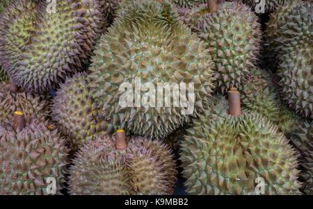 Durian fruits, in Street food market, at Itsara nuphap, Chinatown, Bangkok, Thailand - Stock Photo