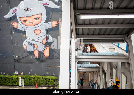 Mural and acces to  skywalk of National Stadium station of BTS skytrain, Bangkok, Thailand - Stock Photo