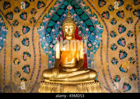 Buddha statue, at Wat Arun (Temple of Dawn), also called Wat Bangmakok Noek, Bangkok, Thailand - Stock Photo