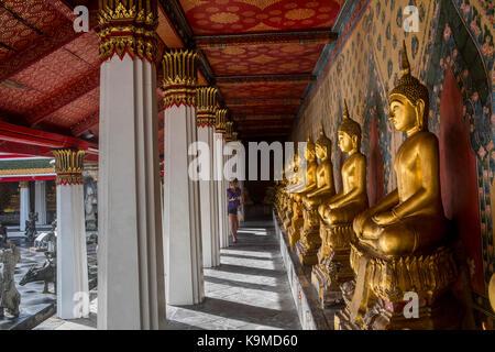 Woman, in Wat Arun (Temple of Dawn), also called Wat Bangmakok Noek, Bangkok, Thailand - Stock Photo