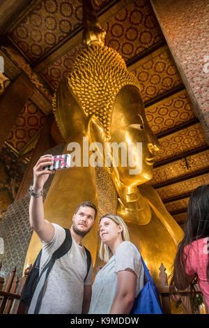 Golden big Buddha, in Wat Pho or Wat Phra Nakhon temple in Bangkok, Thailand - Stock Photo