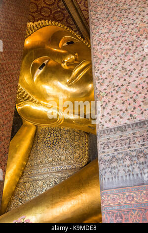 Golden big Buddha, in Wat Pho or Wat Phra Nakhon temple in Bangkok, Thailand - Stock Photo