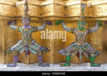 Statues of demons on a Golden Chedi,  at the temple of the Emerald Buddha Wat Phra Kaeo, Grand Royal Palace, Bangkok, - Stock Photo