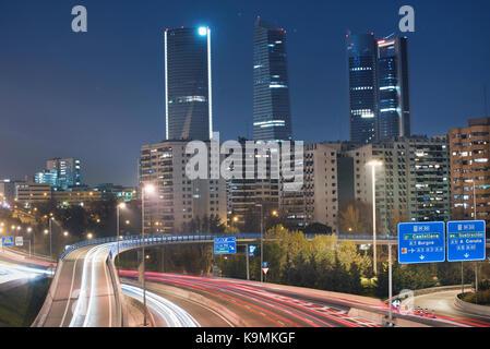 Financial District skyline Madrid, Spain. Rays of traffic lights. - Stock Photo