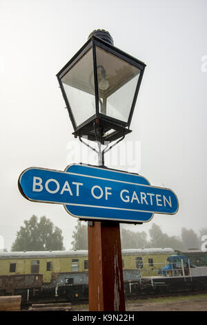 Lamp and sign at Boat of Garten station in Scotland, UK - Stock Photo