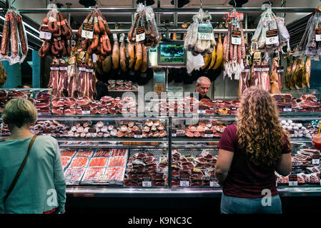 traditional cured meat and sausage shop in la boqueria market of barcelona spain - Stock Photo