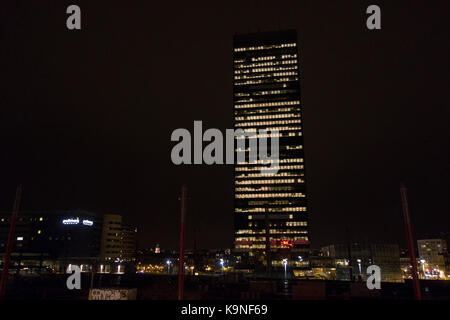 Night time cityscape in Brussels overlooking central train station - Stock Photo