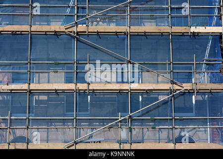 Some scaffolding erected on the front of a period building to allow access for works on restoration to be carried - Stock Photo