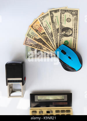 Business concept: computer mouse, seal, old calculator, money located opposite each other on a white background - Stock Photo