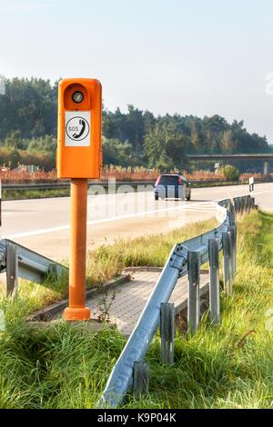 SOS phone. Emergency telephone at the roadside. Morning on the German highway - Stock Photo