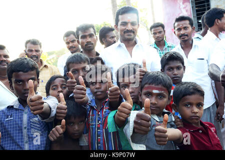 Group Little boy and senior man showing his thumb up - Stock Photo