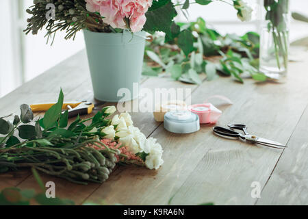 Bouquet of flowers on the table isolated nobody - Stock Photo