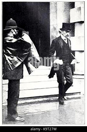 An English 'Bobby' (policeman) salutes Lord Horatio Herbert Kitchener as he leaves the government War Office - Served - Stock Photo