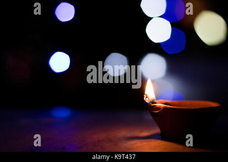 lamps lit up during Diwali in India - Stock Photo