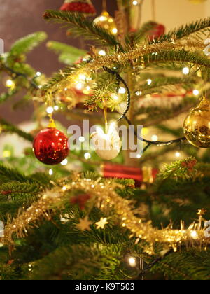 A white dove hangs from a Christmas tree - Stock Photo