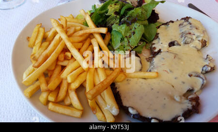 Grilled steak, French fries and Barnaise Sauce - Stock Photo
