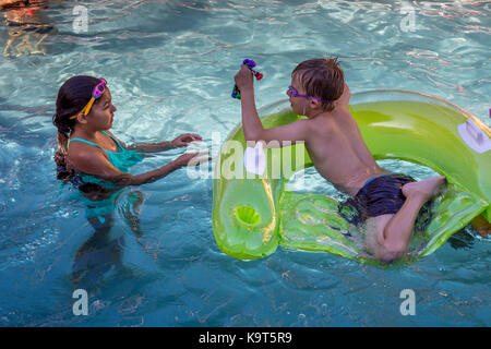 Hispanic boy 5 6 caucasian girl 8 10 year old work together bundle stock photo 27197354 alamy for What is a freshwater swimming pool