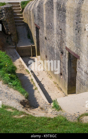 Rear entry to concrete bunker overlooking Omaha Beach above the D-Day landings, Normandy, France - Stock Photo