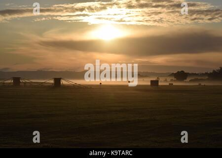 Sunrise over the RNAS Yeovilton in Somerset with the navy air tower and the runway - Stock Photo