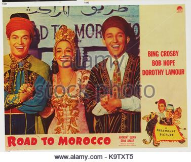 Lobby card for THE ROAD TO MOROCCO (1942) with Bob Hope (left), Dorothy Lamour, and Bing Crosby. The hit film was - Stock Photo