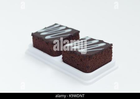 Fresh chocolate brownies isolates on white background - Stock Photo
