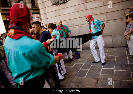 Barcelona, Catalonia, Spain. 24th Sep, 2017. A member of Castellers de la Sagrada Familia (human towers) get ready during La Merce Festival in Barcelona. Catalan separatists and the Catalonia's government continue their campaign towards the referendum of October 1 despite the crackdown carried out by the Spanish government. Over 4,000 members of the Spanish National Police and Civil Guards are being transferred to Catalonia these days. Catalan government aims to celebrate a referendum on independence next first october, the Spanish government is frontally opposed to the referendum and