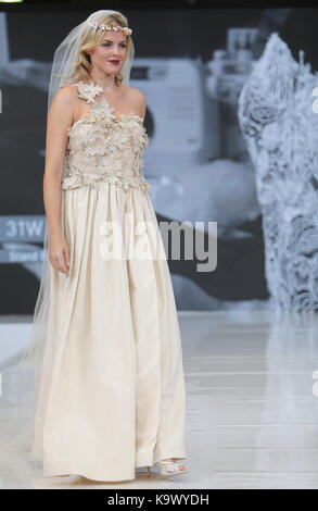 London, UK. 24th Sep, 2017. London Olympia staging the National Wedding Show with a show-stopping Catwalk, The Runway - Stock Photo