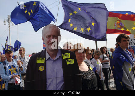 Brighton, UK. 24th September, 2017. Holding a cardboard cutout of Jeremy Corbyn, leader of Britain's opposition - Stock Photo