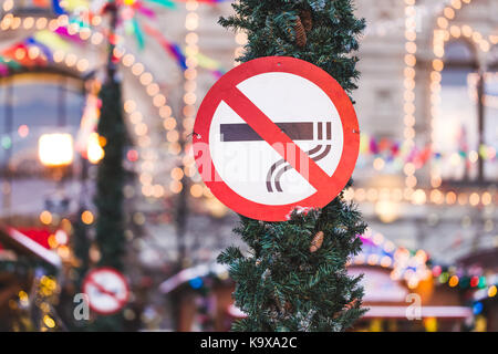 Sign 'no smoking' in the downtown on holiday - Stock Photo