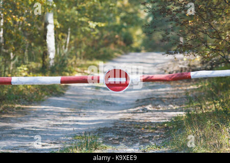 No entry sign in forest - path representing environmental protection - Stock Photo
