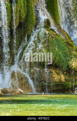 View of the Kravica large tufa waterfalls on the River Trebižat in the middle of the forest. - Stock Photo