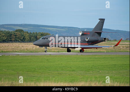 A French built Dassault 900EX Falcon business jet arriving at Inverness Airport in the sunshine. - Stock Photo