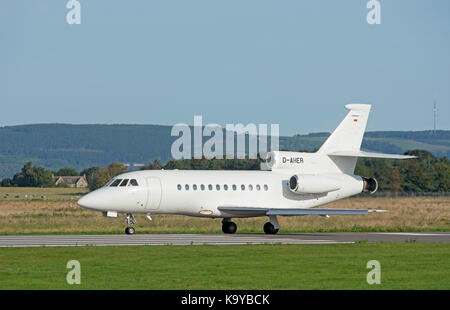 A Dassault 900ex business tri engined Jet arrives at iNVERNESS airport in the Scottish Highlands. - Stock Photo