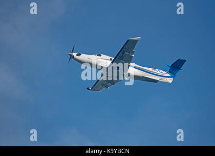 Pilates PC12 NG departing Inverness airport in Highland Scotland. - Stock Photo