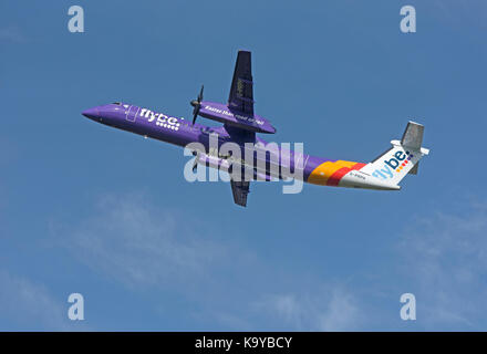 Bombardier Dash 8 Q400 on daily schedule to Inverness Scotland. - Stock Photo