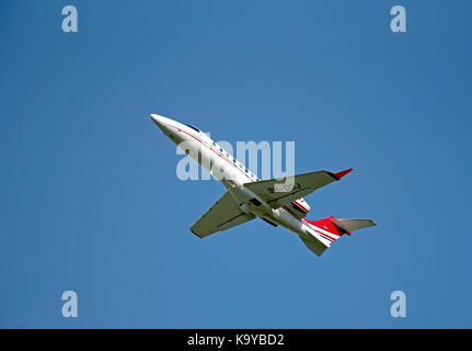 Learjet 75 Luxury business aircraft departing from iNVERNESS in the Scottish Highlands. - Stock Photo