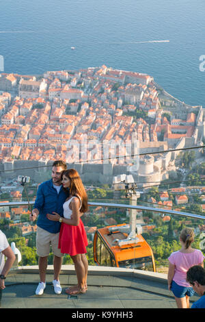Dubrovnik, Croatia - July 21, 2016: couple making selfie on the background of the old town - Stock Photo