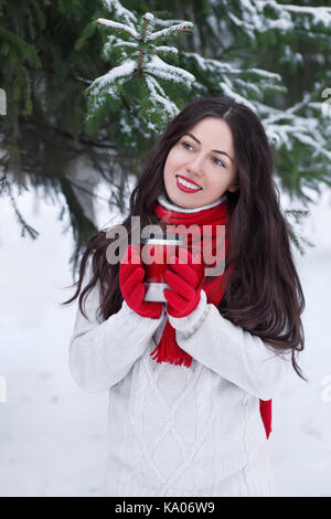 girl drinking hot tea or coffee in winter outdoor. People, leisure, winter, rest, outdoors concept. Young woman - Stock Photo
