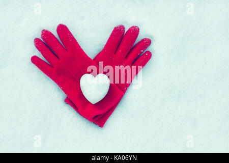 snow heart on red gloves. Winter holidays, Valentine's day, love symbol concept. Valentine's Day greeting card top - Stock Photo