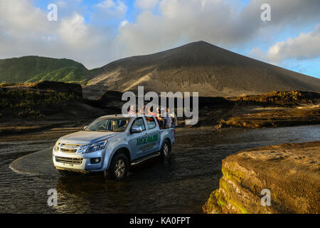 Jeep crosses river below volcano Yasur, Tanna Island, Vanuatu, South Sea, Oceania - Stock Photo