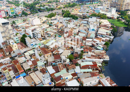 Colorful slum houses at Ho Chi Minh city (view from top), Vietnam. Ho Chi Minh city (aka Saigon) is the largest - Stock Photo