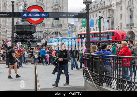 LONDON, ENGLAND - JUNE 09, 2017: Unknown people at Piccadilly Circus near entrance of London subway station, London, - Stock Photo