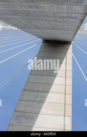 Bottom view of concrete pylon with steel cables from Pont de Normandie over river Seine in France - Stock Photo