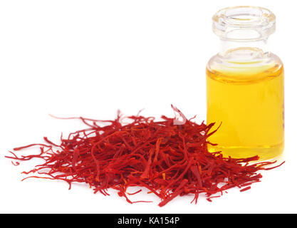 Closeup of Saffron with extract used as food additive over white background - Stock Photo